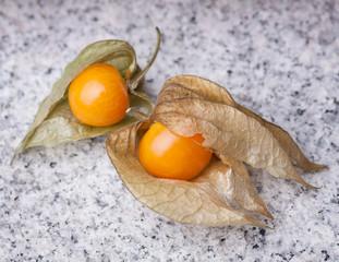 An calyx open, exposing the ripe fruit of physalis peruviana on