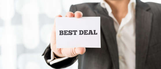 Businessman holding a card - Best Deal