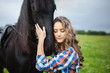 Young beautiful girl with frisian horse - 79296700