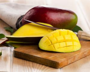 Mango on  a wooden board.