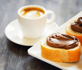 Toasts with chocolate spread and espresso coffee