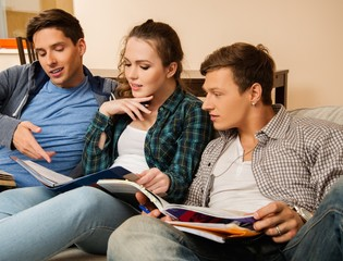 Three students preparing for exams in apartment interior