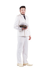 Navy Officer actor smiling in dress white uniform isolated