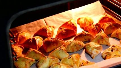 Homemade hamantashen in a hot oven