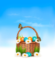Happy Easter background. Basket with eggs and a butterfly agains
