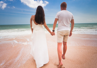 couple at beach and blue sky