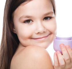Girl applying cosmetic cream