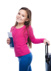 Smiling girl with travel bag, ticket and passport