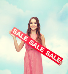 young woman in dress with sale sign