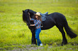 Young beautiful girl with frisian horse - 79306198