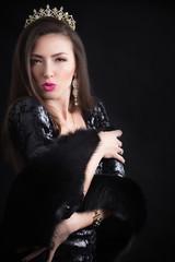 Beauty model woman wearing fur coat, diamond crown