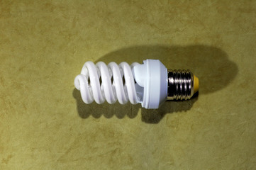 fluorescent light bulb with highlights on a green background