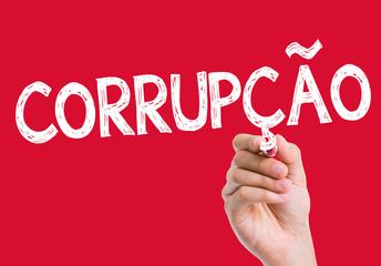 Corruption (Corrupcao in Portuguese) written on the wipe board