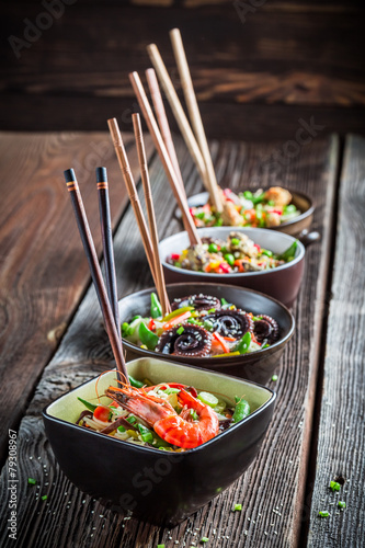 Few traditional asian noodles with vegetables - 79308967