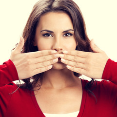 Portrait of beautiful woman covering with hands her mouth
