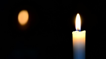puting out of candle, real time,natural lighting
