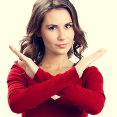 Portrait of serious woman showing stop or reject gesture