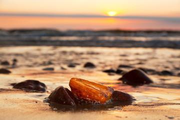 Amber stone on the beach. Precious gem, treasure. Baltic Sea