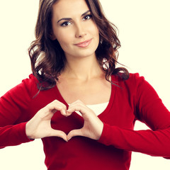 Young woman showing heart symbol gesture