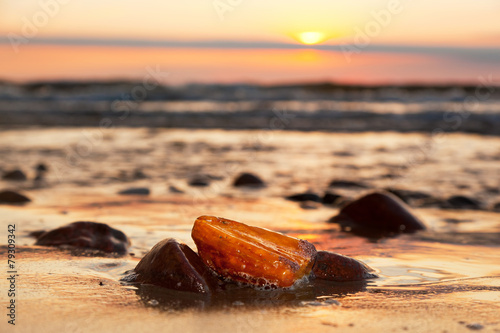 Amber stone on the beach. Precious gem, treasure. Baltic Sea - 79309342