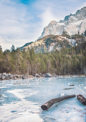 Frozen forest lake in Bavarian Alps near Eibsee lake, winter