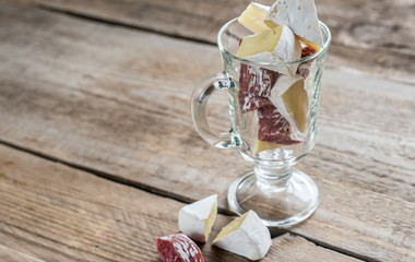 Slices of Camembert and salami in the glass