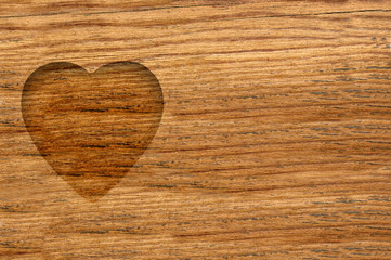 wooden heart in wooden background