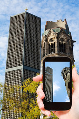 tourist taking photo of kaiser wilhelm church