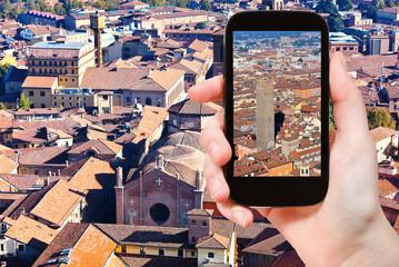 tourist taking photo of center Bologna city