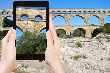 tourist taking photo of Pont du Gard