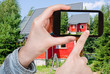 tourist taking photo of new small country house