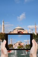 tourist taking photo of Haghia Sophia
