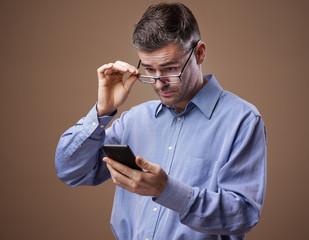 Man adjusting his glasses