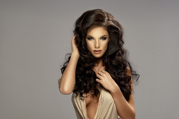 Portrait of beautiful sensual brunette woman with long hair.