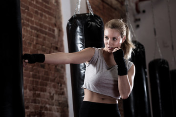 Girl training kick boxing