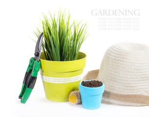 garden equipment with plant and green plants isolated on white