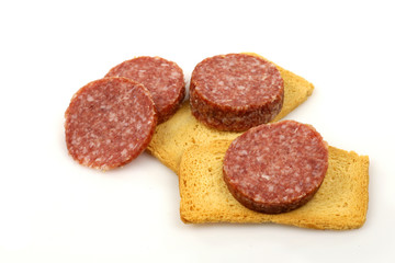 sausage slices and toast on a white background