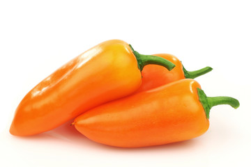 fresh orange peppers (capsicum) on a white background