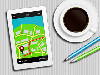 tablet with gps navigation application, coffee and pencils lying