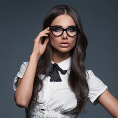 Elegant business woman wearing eyeglasses