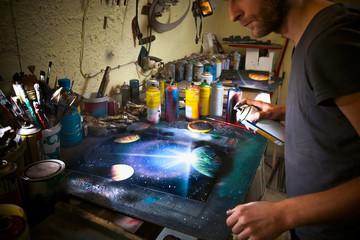 Street artist working in his studio