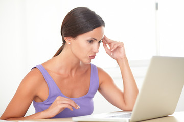 Fatigued lady surfing the web on computer