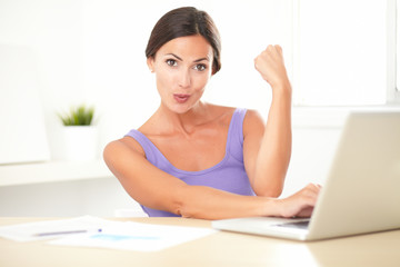 Brunette satisfied lady working on her computer