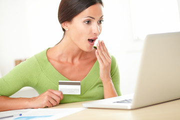 Shocked female using her credit card to buy
