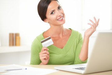 Smiling young woman buying on e-commerce from home