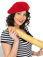 Attractive Young Woman Eating a French Stick Bread Loaf