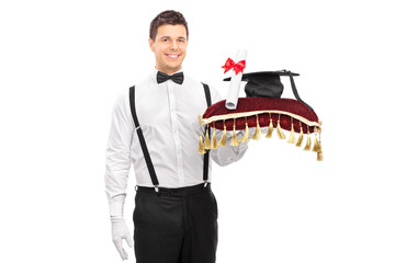 Male butler holding a diploma and a mortarboard