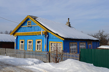 Old blue wooden house in winter