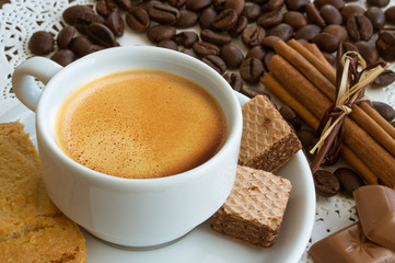 a cup of coffee with coffee beans