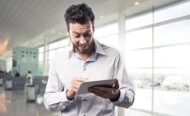 Joyful man using his tablet